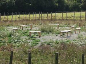 A set of chestnut garden benches