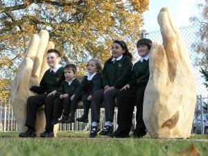 Carved oak hands with oak struts between