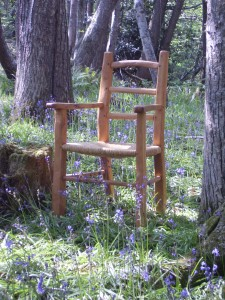 Chestnut carver chair with rush seat