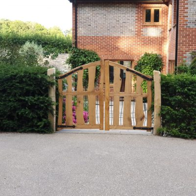 Chestnut entrance gate with bespoke flower metalwork