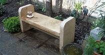 Oak bench with arm rest