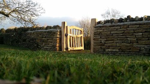 Chestnut gate stone wall open