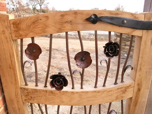 Oak garden gates with decorative metalwork