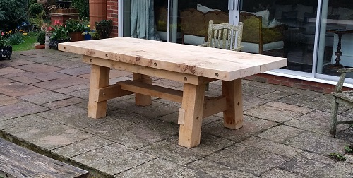 7cb1241a85e9 This bespoke commission was for an solid oak garden table to replace the  clients previous wooden table. The brief was a solid oak piece with bolted  top and ...