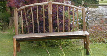 Curved back chestnut bench