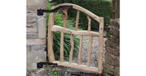 Curved chestnut garden gate